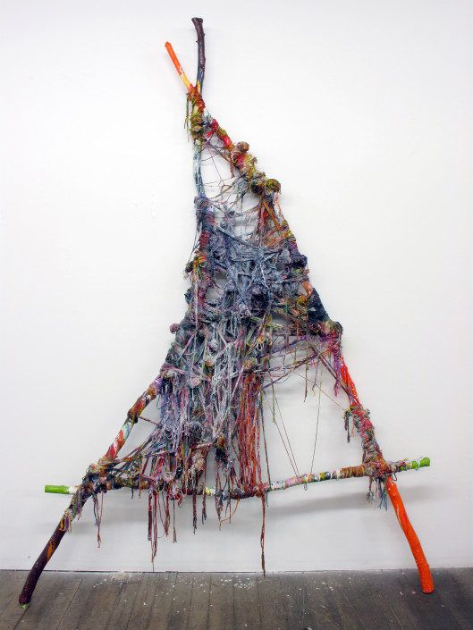 Jacin Giordano. Unravel 14, 2014. Yarn, acrylic and tree branches. 96 x 67.5 in.