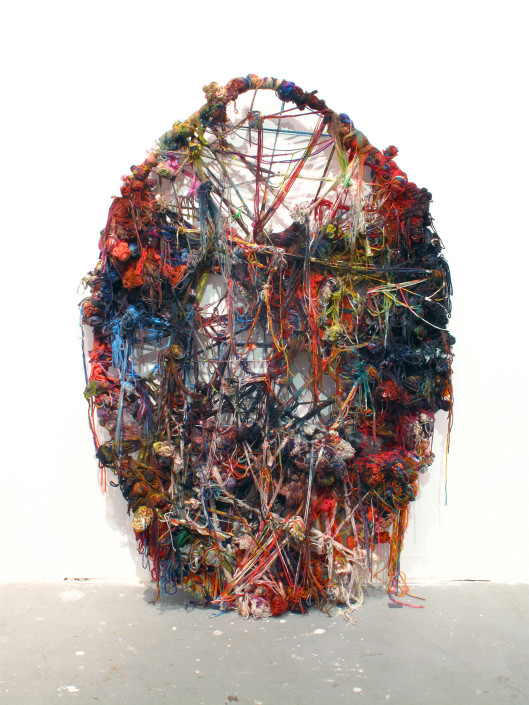 Jacin Giordano. Unravel 12, 2012. Yarn, acrylic, wire and tree branches. 57 x 38.5 in.