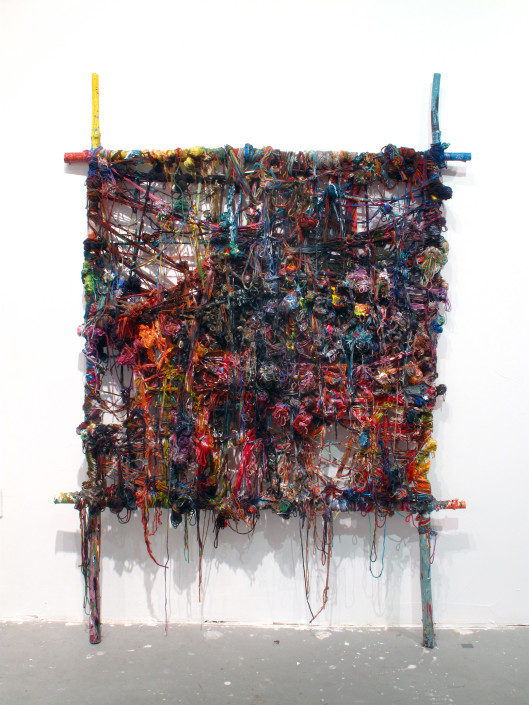 Jacin Giordano. Unravel 6, 2012. Yarn, acrylic and tree branches. 79 x 58 in.