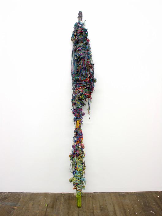 Jacin Giordano. Harpoon for Hunting Rainbows (Grey), 2013. Yarn, acrylic and tree branch. 82 x 8 x 9 in.