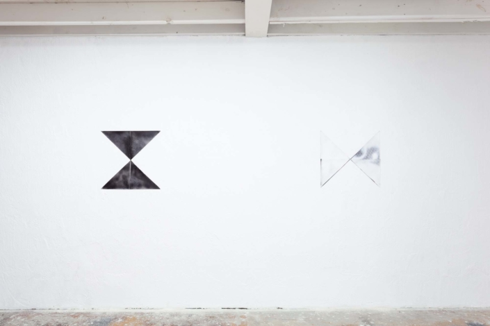 Left: Erin Thurlow, untitled(black), found newspaper and spray paint, 2019, Right: Erin Thurlow, untitled(white), found newspaper and spray paint, 2019